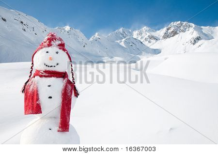 Happy snowman in mountain (copy space)