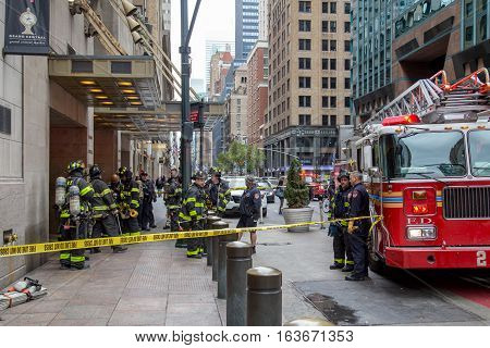 New York, United States of America - November 20, 2016: Firemen waiting in front of the  Grand Central Market in Manhattan