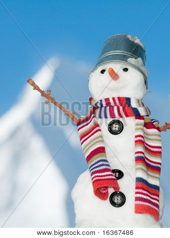 Happy snowman on mountain