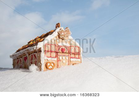 Christmas cookies house in snow (oneself made cookies house)