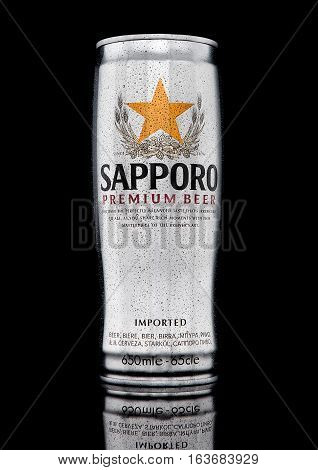LONDONUK - JANUARY 02 2017: A can of Sapporo Beer with frost on black background. The Japanese brewery was founded in 1876 by German trained brewer Seibei Nakagawa. It is the oldest beer brand in Japan.