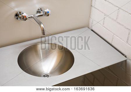 Washbasin in bathroom, minimalist modern metal sink, antivandal washbasin