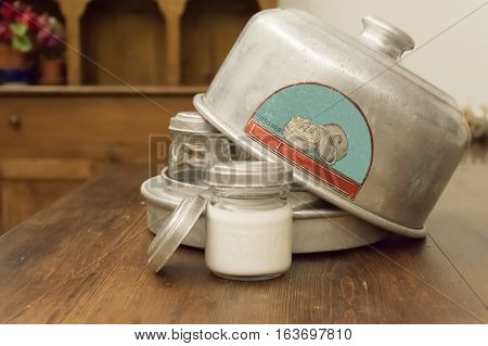 Old yogurt aluminum with glass jars and aluminum cover