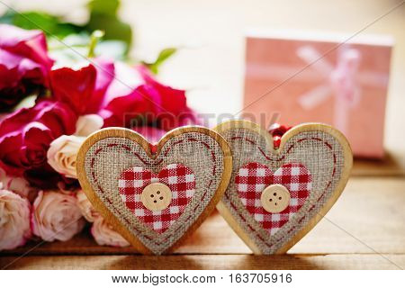 Heart shapes, colorful roses and pink gift box