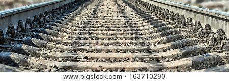 Rail transportation. Railroad tracks sleepers.Rails stretching into the horizon