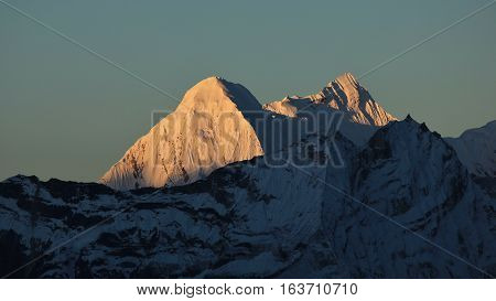 High mountains of the Himalayas bright lit by the first sunlight of the day. View from Chukhung Everest National Park.