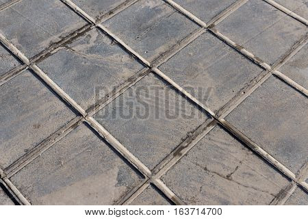 concrete tile for outdoor use Sidewalks, non-slip and wear resistance paving with tile Dirty and broken hydraulic tiles, pattern detail