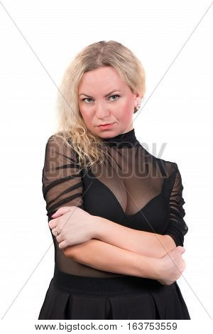 Sexy blonde woman with big breasts in a transparent dress isolated on white background. Attractive woman with large boobs and curly hair.