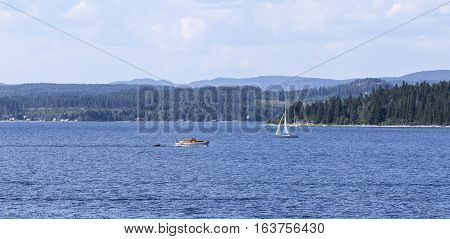 BALTIC SEA, SWEDEN ON JULY 25. View of a motorboat passes the photographers position on July 25, 2013 at the Baltic Sea, Sweden. Sailboat in the background. Editorial use.