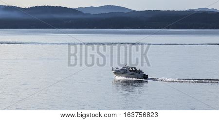 BALTIC SEA, SWEDEN ON JULY 25. View of a motorboat, speedboat passes the photographers position on July 25, 2013 at the Baltic Sea, Sweden. Calm sea and speed. Editorial use.