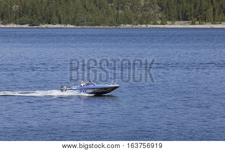 BALTIC SEA, SWEDEN ON JULY 26. View of a motorboat, speedboat passes the photographers position on July 26, 2013 at the Baltic Sea, Sweden. Calm sea and speed. Editorial use.