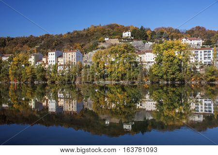 Reflection of modern french houses in the river in Europe