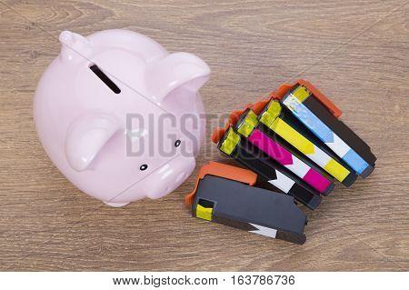 Set Of Printer Ink Cartridges With A Piggy Bank