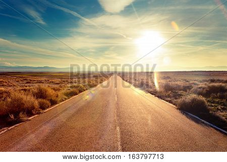 Road through landscape. Road and car travel scenic and sunset. Road travel concept.Car travel adventures.