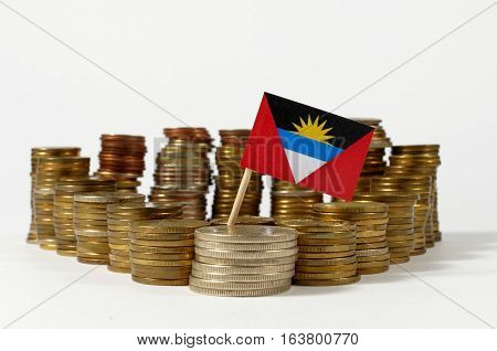 Antigua And Barbuda Flag Waving With Stack Of Money Coins