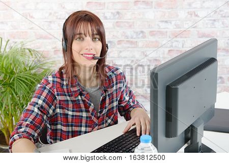 cheerful beautiful young girl support phone operator with headset
