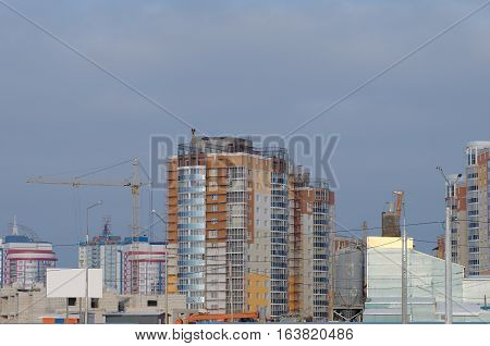 SARANSK, RUSSIA - DECEMBER 3, 2016: New slipping quarter under construction in Saransk. Photo taken at the sunset.