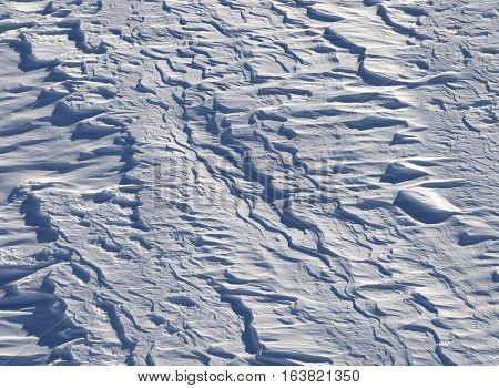 Off-piste after snowfall in ski resort at sun winter day. Natural background.