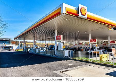 Luxembourg - April 10 2016: Shell gas station on the border of Luxembourg and France. The cheapest fuel in Central Europe. Shell is an Anglo-Dutch multinational oil and gas company headquartered in the Netherlands and incorporated in the United Kingdom.