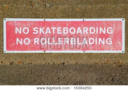 No Skateboarding sign, covered in marks from skateboards and rollerblades!