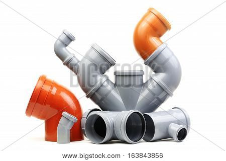 New gray and brown drain pipes isolated on white