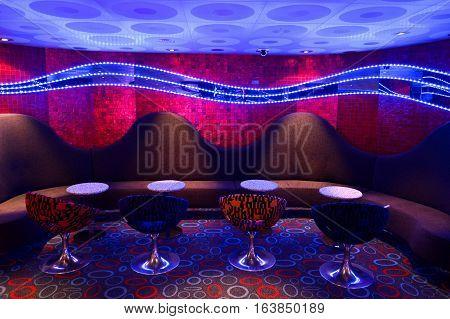Bar tables and bar stools in natural light
