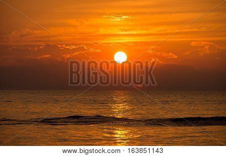 boat wake pattern on Lake Michigan at sunset time