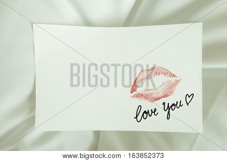 Sexy Red Lipstick Kiss 'love You' Heart On White Note On White Bed Pillow Sheet In The Morning Light