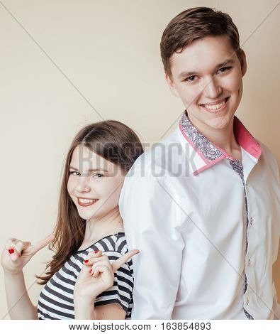 couple of happy smiling teenagers students, warm colors having a kiss, lifestyle people concept, boy and girl together close up