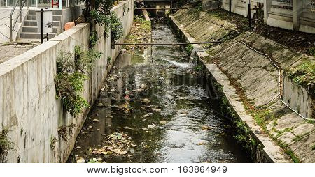 Dirty ditch with garbage photo taken in Semarang Indonesia java