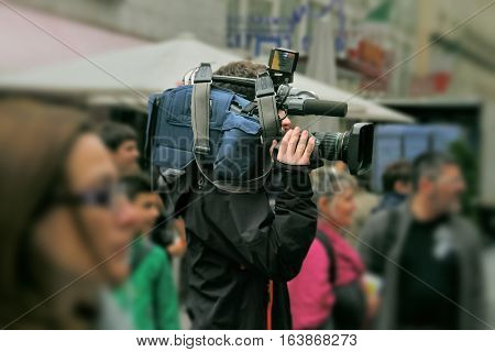 The cameraman shooting an interesting news rightnow