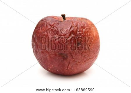 Old dry ribbed red apple, rotted apple, natural texture.