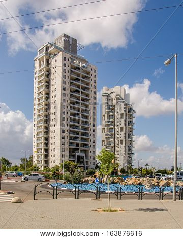 Rishon LeZion, Israel-May 28, 2016: Two modern multi-story apartment residential buildings located at Golda Meir Street in Kiryat Rishon district. Vertical shot in bright sunny day on blue sky background