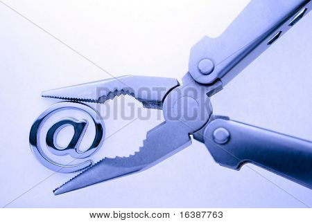e-mail symbol and pliers