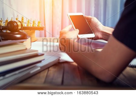 Young Business Lawyer Man Using Mobile Smart Phone In His Office Desk, Vintage Tone Of Photography W