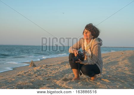 Enjoying Woman Photographer Smiles