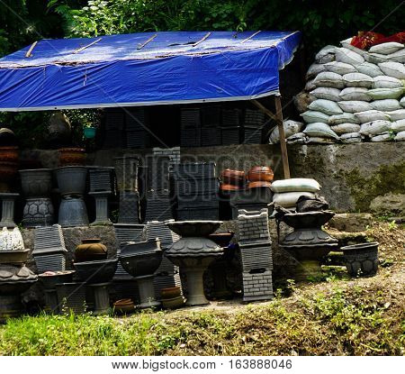 Garden material shop sells many kind of stone pot and fertilizer photo taken in Semarang Indonesia java