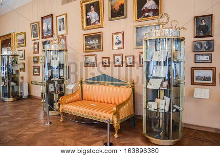 Moscow, Russia - August 30, 2016 - Antique living room with furniture in the old mansion house. Sofa, exhibition stands, paintings from collection of The State A.S.Pushkin Museum. 18th-19th century.
