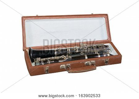 Case with an old clarinet isolated on white background.
