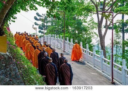 KAOSHIUNG, TAIWAN - NOVEMBER 24: View of monks walking to pray in a temple on Fo Guang Shan a famous Buddhist monastery in Taiwan on November 24, 2016 in Kaoshiung