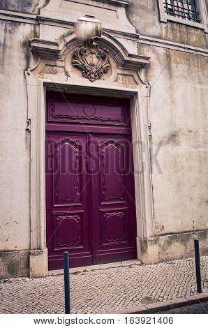 Burgundy door in the city of lisbon  portugal