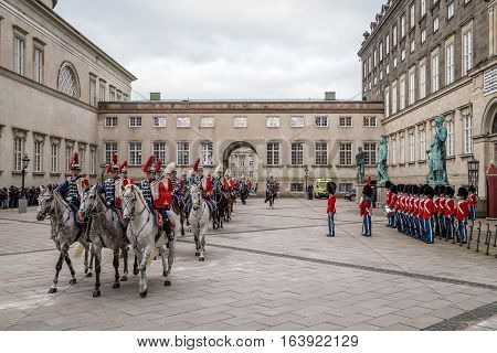 Copenhagen Denmark - January 04 2017: The Guard Hussar Regiment and Royal Guards preparing for escorting Queen Margrethe in a 24-carat golden coach from Christiansborg Palace to Amalienborg Palace
