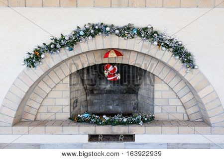 a fireplace with modest christmas a decoration