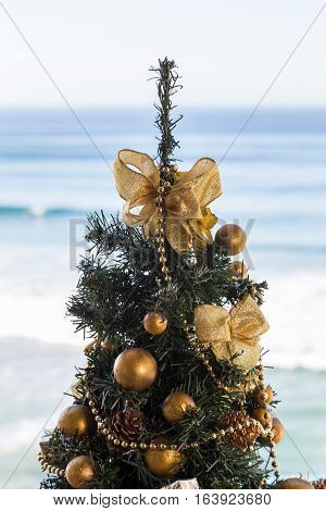 Christmas Tree With Gold Decoration On Waves Of Sea