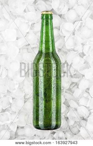 green bottle of light beer is cooling in the ice