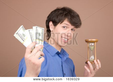 Young Businessman With Sand-Glass And Money
