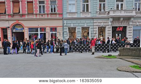 NOVI SAD SERBIA - MAY 13: People waiting for opening H&M first store in Novi Sad Serbia on May 13 2016. Novi Sad is the second largest city of Serbia.