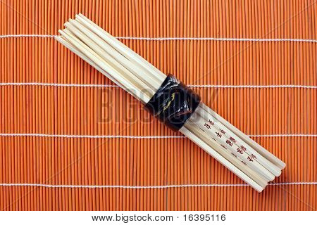 chopsticks on bamboo placemats