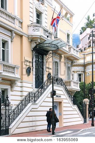 MONTE CARLO MONACO - February 02: Branch of Barclays bank building with people on the sidewalk in Monte Carlo Monaco - February 02 2016; Barclays is a British multinational banking and financial services company with branches in many countries.