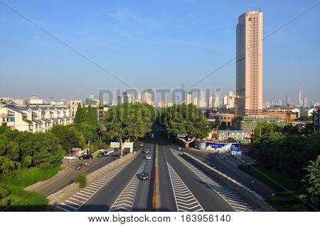 NANJING, CHINA - JUL.22, 2012: Nanjing City Skyline and Zhong Shan Dong Lu (East Zhongshan Road), viewed from Zhongshan Gate, Nanjing, Jiangsu Province, China.